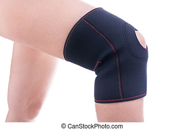 Injured knee in orthopedic bandage. Female athlete.