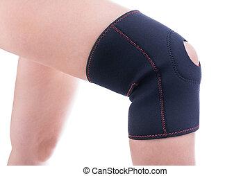 Injured knee in orthopedic bandage. Female athlete.