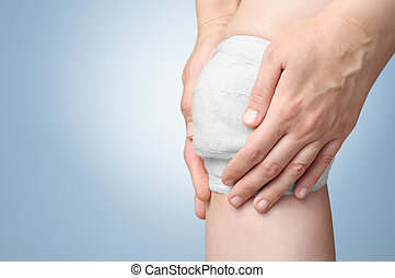 Injured knee with bandage