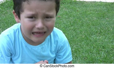 Injured little boy crying