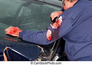 Injured man and wrecked car