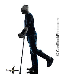 injured man careless walking with crutches silhouette