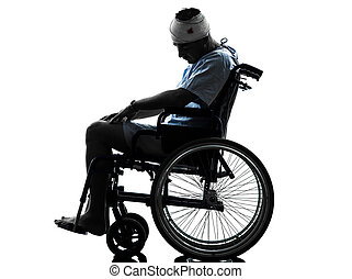 injured man in wheelchair  silhouette