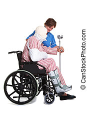Injured man in wheelchair with nurse