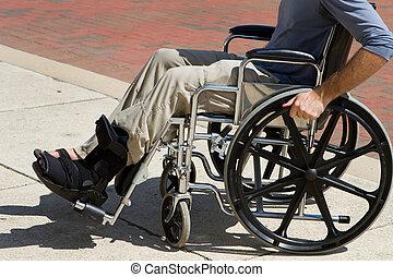 Injured Man Wheelchair - Injured man with a broken foot...