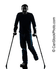 injured man with crutches silhouette
