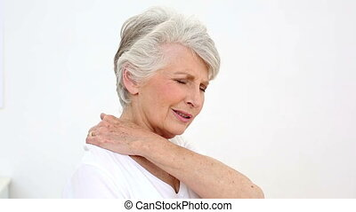 Injured patient rubbing her neck at the rehabilitation...