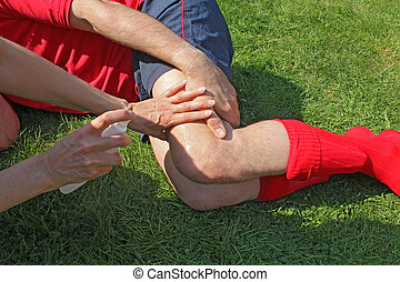 Injured sportsman on grass - Injured sportsman lying on...
