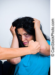 Injured woman  being scared about  man fist
