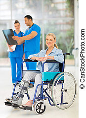 injured woman on wheelchair with doctors