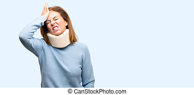Injured woman wearing neck brace collar terrified and nervous expressing anxiety and panic gesture, overwhelmed