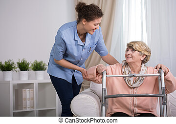 Injured woman with walker - Senior injured woman with walker...