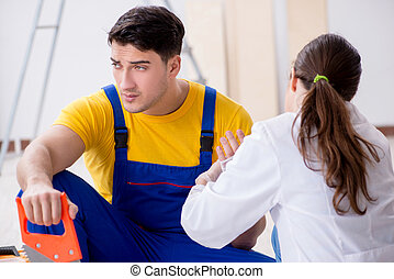 Injured worker being assisted by doctor