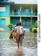 Injury leg against flood school, Thailand - Thai student...