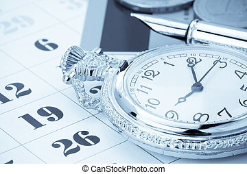 ink pen and coin money on calendar background