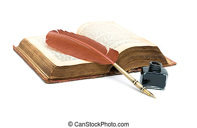 inkwell, pen and an old open book isolated on white background. horizontal photo.