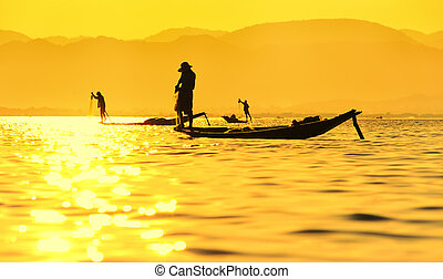 Inle lake sunset and fisherman
