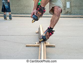 inline skater slides down a tube