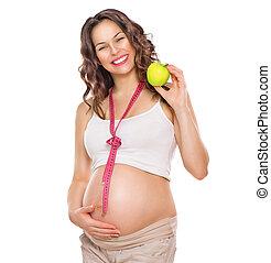 innehållsrik kvinna, mätning, henne, stor, mage, och, äta, apple., frisk mat