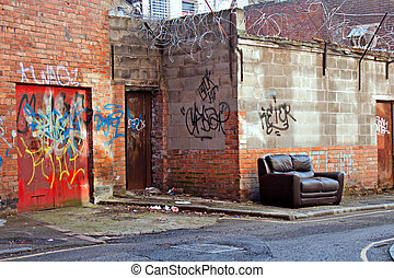 Inner city dereliction - Abandoned couch in inner city ...