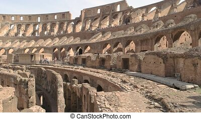 Inner part of Coliseum. Old ruins and sunlight.