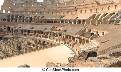 Inner part of Colosseum, people. Ancient landmark of Rome.