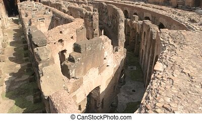 Inner part of Colosseum. Ruins and sunlight. Remnants of...