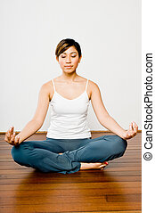 Inner Peace - Sporty woman practicing yoga