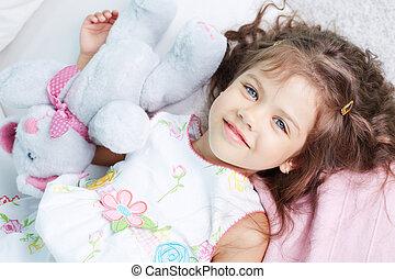 Innocent girl - Portrait of lovely girl lying with teddybear...