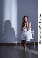 Innocent scared rape victim in white dress