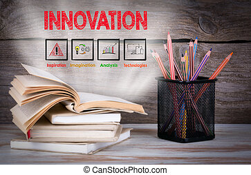 Innovation, Business Concept. Stack of books and pencils on the wooden table.