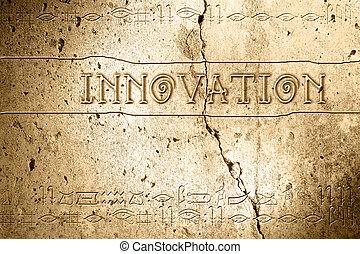 innovation - word innovation on wall with egyptian alphabet...