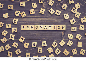 Innovation word wood block on table for business concept.