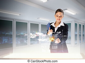 Innovations in business - Image of young businesswoman...