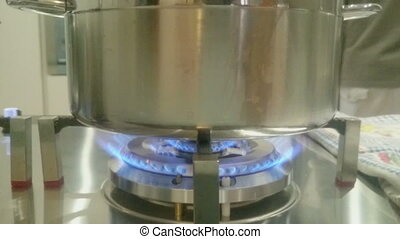 inox pot kitchen cooking - inox pot on gas cooker in the...
