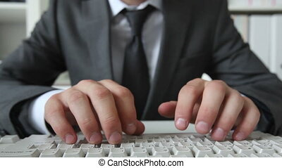 Input - Close-up of business guy inputting information via...