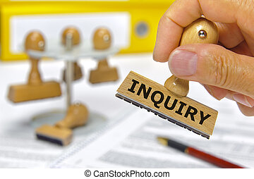 inquiry - rubber stamp in hand marked with inquiry