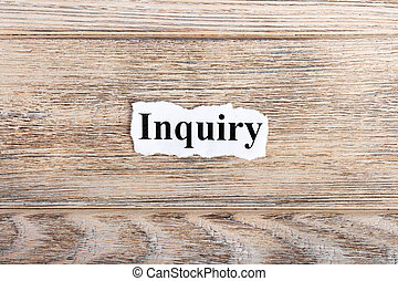 Inquiry text on paper. Word Inquiry on torn paper. Concept Image