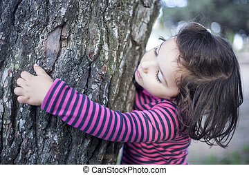 touching  affectionately a tree