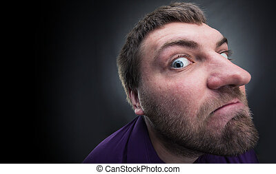 Adult bearded inquisitive man over grey background