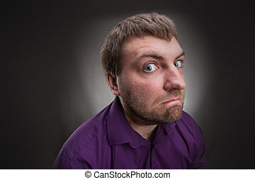 Inquisitive man - Frustrated inquisitive man over grey ...
