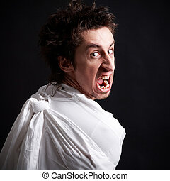 Insane rage - Insane man in strait-jacket screaming in...