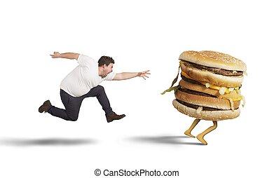 Insatiable fat man runs for catch sandwich
