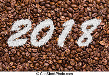 Inscription 2018 on the background of coffee beans.