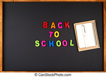 inscription back to school from multi-colored plastic letters
