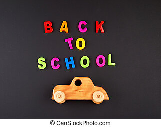 wooden baby car on black chalk board, concept back to school
