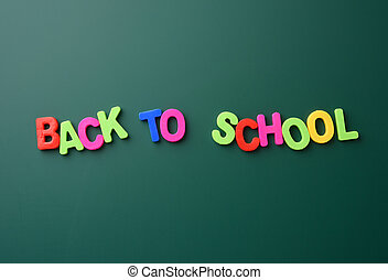 inscription back to school from multicolored plastic letters