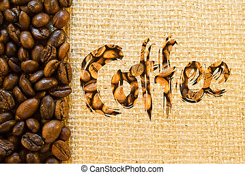 Inscription coffee lined wuth coffee beans