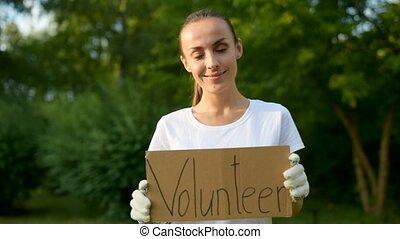 inscription, femme, affiche, jeune, gai, papier, tenue, volontaire