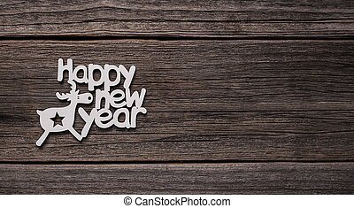 Inscription Happy New Year on wooden background.